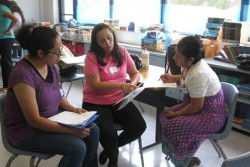 Parent mentor coordinators prepare for a group presentation.