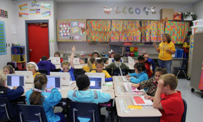 Students in Julie Needham's third-grade class work on individual lessons on laptops. (Photo by Jackie Mader)