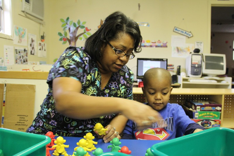 Jennifer Calvert, director of the ABC Pre-School & Nursery Inc. in Aberdeen, Miss., helps a student build a pattern during a morning activity. (Photo: Jackie Mader)