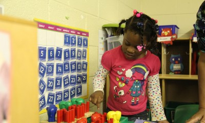 A student in Jennifer Calvert's pre-K classroom counts colorful toys. Calvert says she will be able to buy more materials and technology with the help of state funds. (Photo: Jackie Mader)
