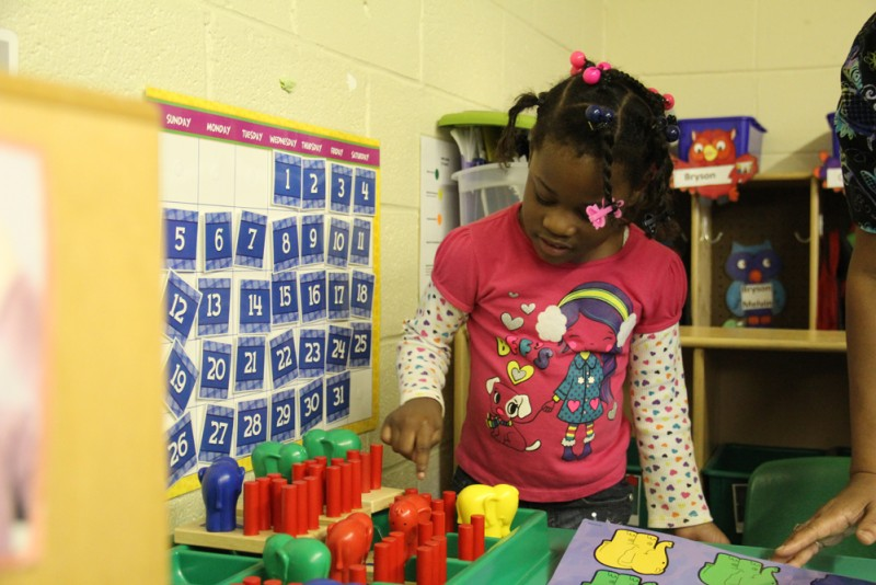 A student in a Mississippi pre-K classroom counts colorful toys. Her teacher says she will be able to buy more materials and technology with the help of state funds.