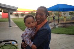 Charter school teacher Noelle King with son Colin, age eight months, outside KIPP SHINE Prep in Houston. (Photo: Rachel Monahan)
