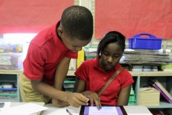 Kiara McPherson and Jeremiah Hilliard, two students at Em Boyd Elementary, work on a science project. Students say they prefer the iPads to the desktop computers that they used to use in class.