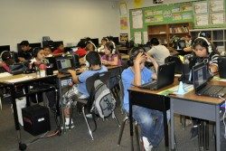 Students at Corona-Norco Unified's Louis VanderMolen Fundamental Elementary use laptops for daily reading instruction as well as to prepare for the state's new computerized testing. Some of the school's laptops were purchased under a funding system that restricted their use to specific student groups, such as English learners. Tools purchased under the state's new funding system will be available to a greater share of students.