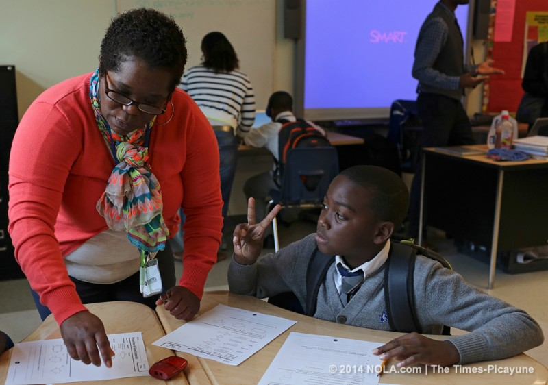 "Ikeeve Bush works with 5th grade math teacher Semaj Brown in a break out group at Arthur Ashe Charter School on Friday, April 25, 2014.Arthur Ashe's ""blended learning"" program is nationally praised, with classes that include both computerized and personal instruction. (Photo by Julia Kumari Drapkin, Nola.com 