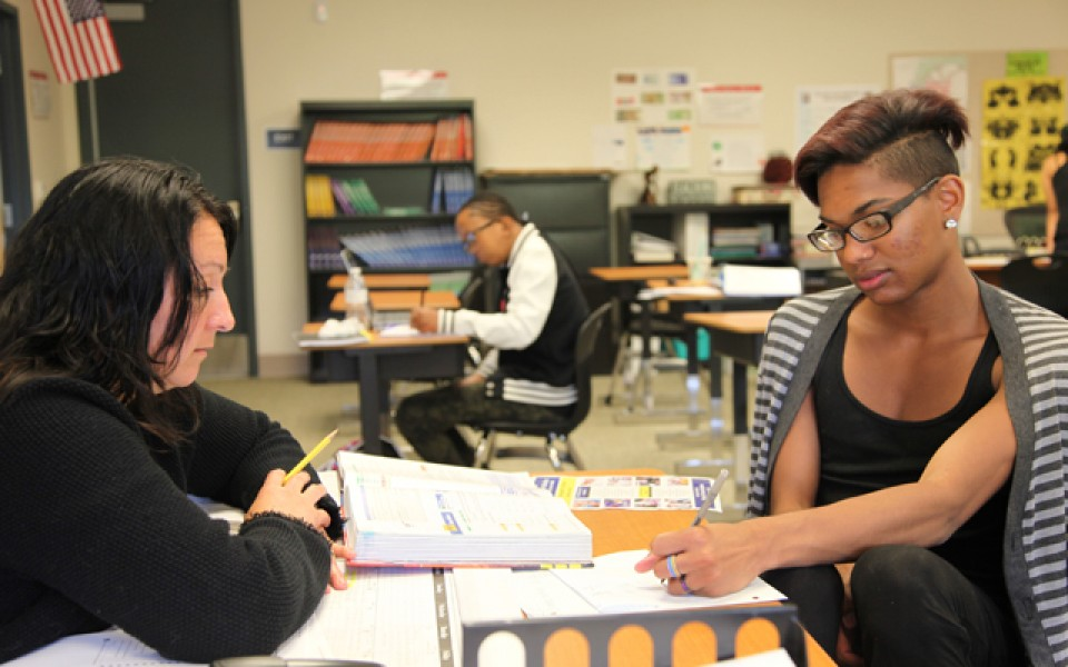 Carmen Quinonez, a teacher at a dropout program in Riverside County, Calif. called Come Back Kids, guides Quincey Bennett, 18, through an algebra problem. (Photo: Brenda Iasevoli)
