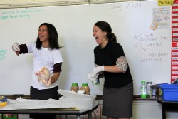 Sixth-grade teachers Erica Silva (left) and Allison Pazar lead a project on how to mummify a chicken as part of a social studies unit on ancient Egypt at Oscar Romero Charter Middle School in central Los Angeles. There's plenty of time for hands-on lessons like these thanks to Romero's 10-hour school day. (Photo: Brenda Iasevoli)