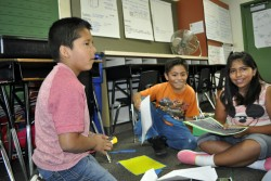 Ronald Bracamontes, 8, Christian Zaragosa, 9, and Jocelyn Buenrostro, 9, teamed up to experiment with paper airplane designs during a summer school program at Romero-Cruz Elementary in Santa Ana Unified. The team conducted nine tests on three designs to see which one generated the smoothest landings.