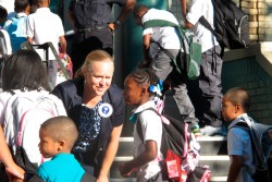 Newark School Superintendent Cami Anderson, second form left, welcomes students to the first day of classes at Peshine Avenue School in Newark, N.J., Thursday, Sept. 4, 2014. (AP Photo/Geoff Mulvihill)