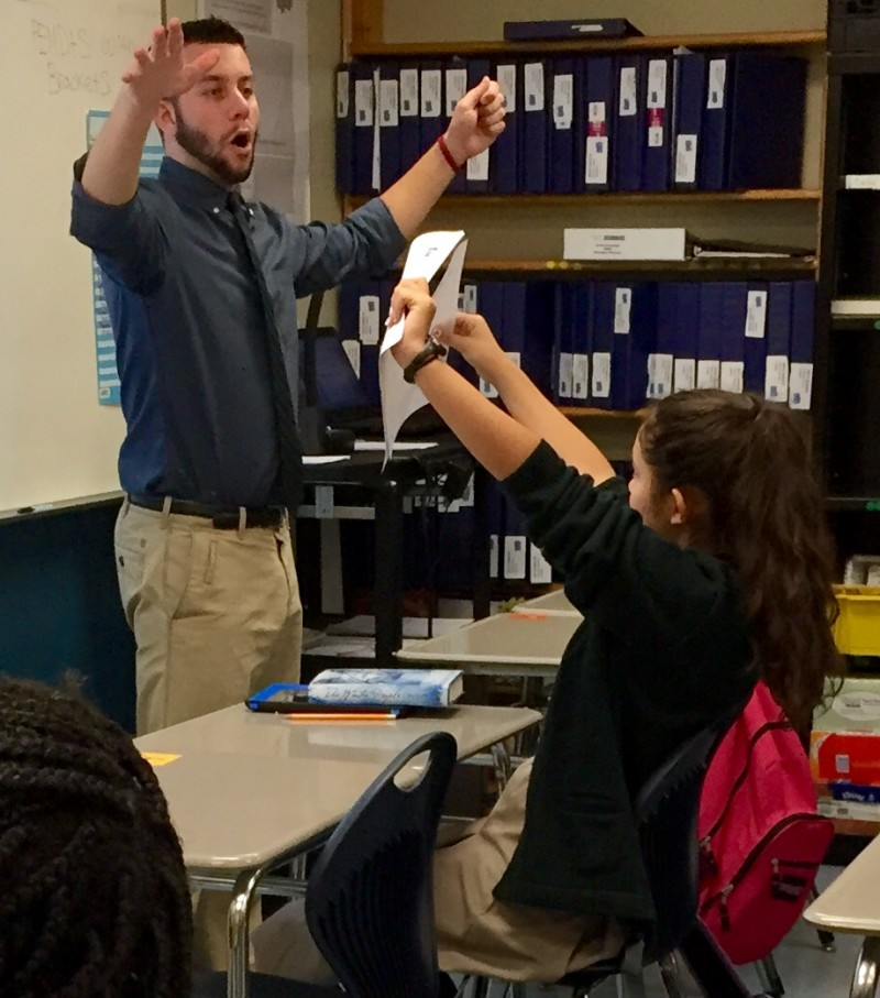 James Cavanagh challenges his math students to pass out papers in 15 seconds or less. He is struck by the importance ascribed to every moment at his high-performing charter school. (Photo: Sara Neufeld)