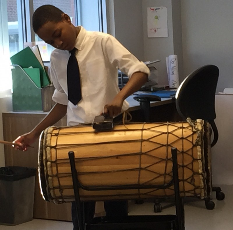 Kamron Oglive, a sixth-grader at Brooklyn Ascend Charter School, participates in the African drumming orchestra after school. The school shortened its academic day this year to make teachers' jobs more sustainable but steers students into after-school programming. (Photo: Sara Neufeld)