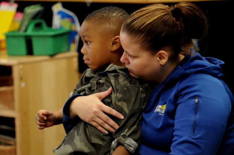 New Horizon Academy pre-kindergarten teacher Jaime Linton, right, comforts Demariay Gunn after he gets upset while playing. (Jean Pieri / Pioneer Press) No reproduction