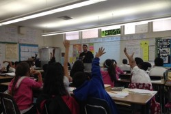 When fourth-grade teacher Angel Chavarin asks his students to share examples of inferences with the whole class, he gets a lot of volunteers willing to share their ideas. (Photo: Pat Wingert)
