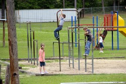 Children in the Richton School District, about 20 miles east of Hattiesburg, play on outdated playground equipment. Across Mississippi, educators say that years of underfunding have left them with inadequate facilities and few supplies. (Photo: Jackie Mader)