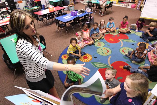 Kindergarten teacher Haley Stewart teachers reads to her students at Parkway Elementary in Tupelo, Miss. (Adam Robison, Northeast Mississippi Daily Journal)