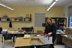 Veteran teacher Erin Sears unpacks in her new classroom at Morris Jeff Community School.