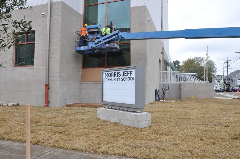 The new school carries the charter school's name on its yard sign, but that differs from the name on the building.