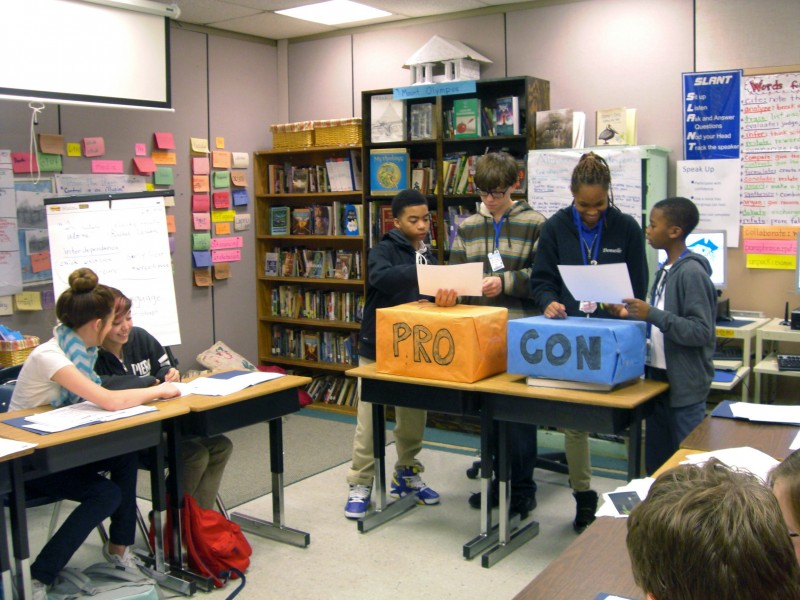 Sally Meredith's students debate whether all public school students should be randomly drug tested. Kai Hart, far left, and Ian Carbo argue in favor of the tests; Donielle White and Keva Peters, at right, are opposed.