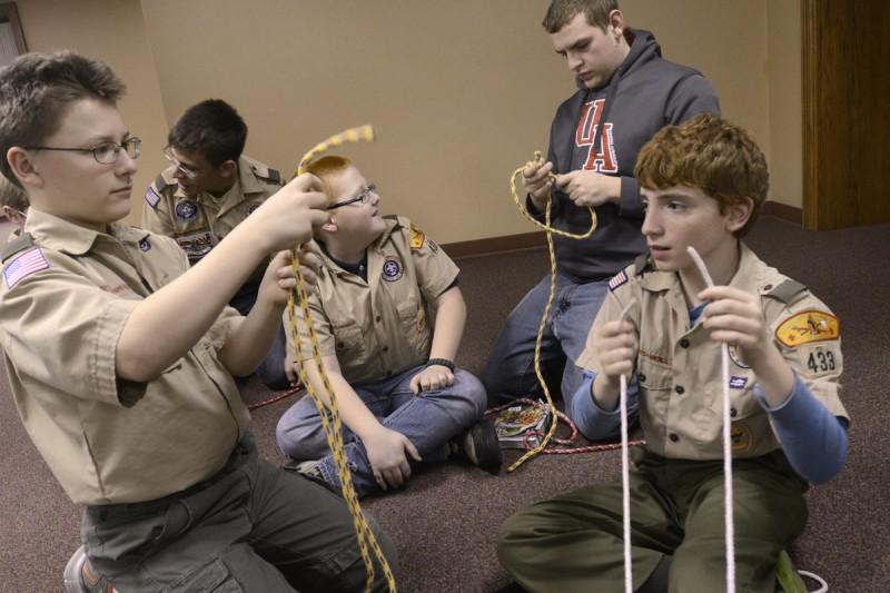 Scouts help one another as they practice tying knots during a meeting for Boy Scout Troop 433 on Tuesday, March 4, 2014, at Mt. Olive United Methodist Church near Marion, Ind. From left are Levi Hofmann, Brad Burchell, Ethan Embry, Ben Weaver and Allen Farmer.