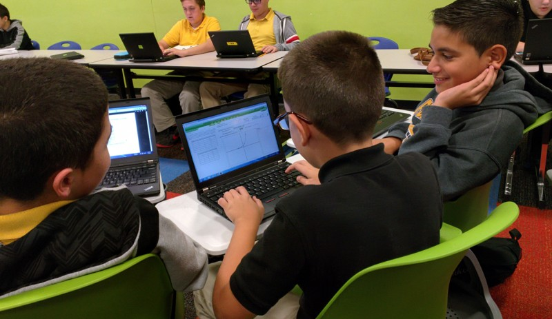 Students in a blended learning class in W.R. Thomas Middle School, in the Miami-Dade County Public School system, work on a math problem.