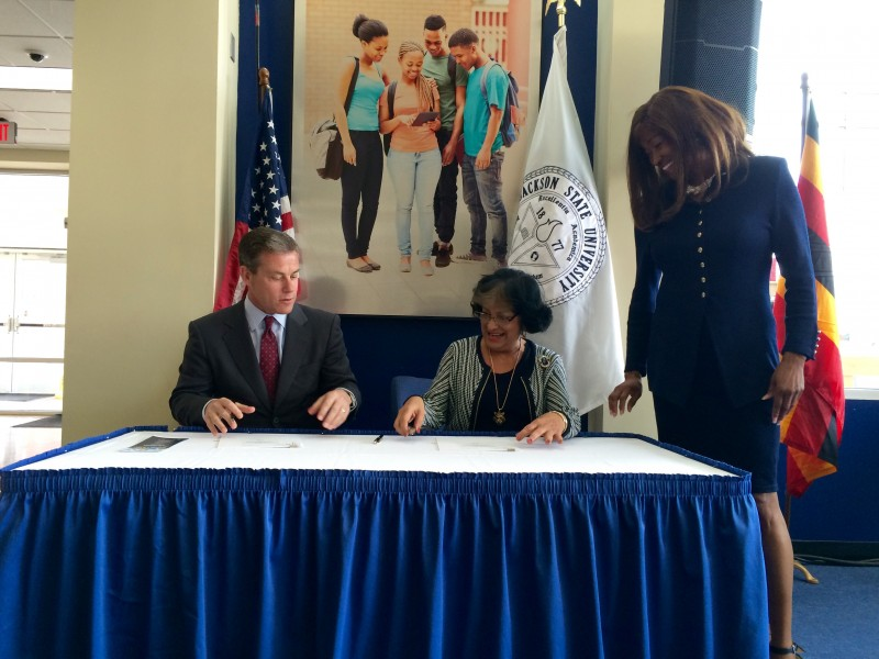 CIEE President James Pellow and JSU President Carolyn Meyers sign the agreement to work together on study abroad programs. Special assistant to the provost for international programs Priscilla Slade (right) organized much of the partnership.