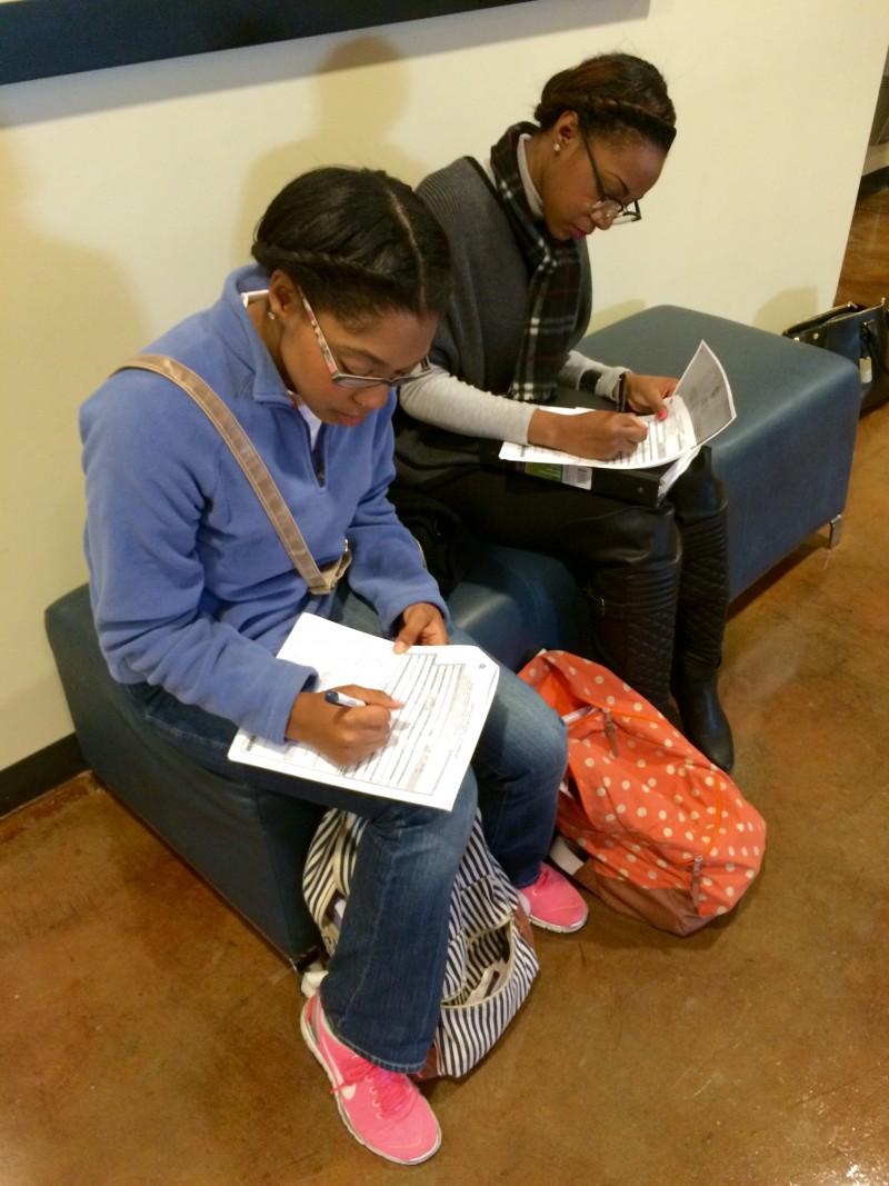 JSU students Jasmine Harvey (left) and Julia Stotts fill out their passport application forms.