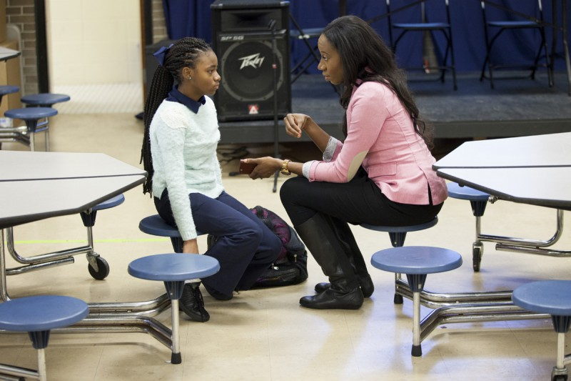 New principal Krystal Hardy chats with a student in the cafeteria/auditorium at Sylvanie Williams College Prep elementary school, on January 16, 2015 in New Orleans, Louisiana. No reproduction.