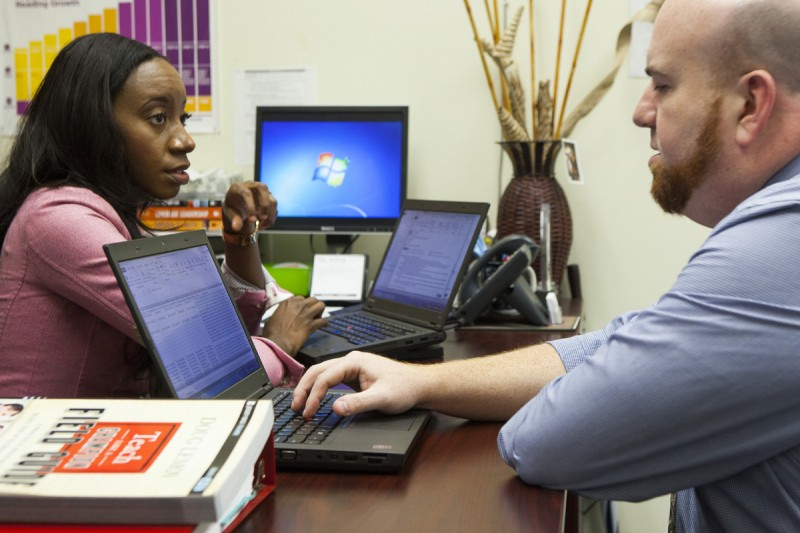 Principal Krystal Hardy works with her mentor, William Murphy, in her office at Sylvanie Williams College Prep elementary school, on January 16, 2015 in New Orleans, Louisiana. No reproduction.
