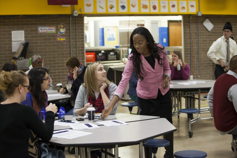 New principal Krystal Hardy meets with teachers and staff during 'morning circle' before school starts at Sylvanie Williams College Prep elementary school, on January 16, 2015 in New Orleans, Louisiana. No Reproduction.