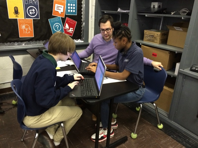 Coding teacher Michael Burgevin helps his students during class at Liberty Collegiate Academy in Nashville.