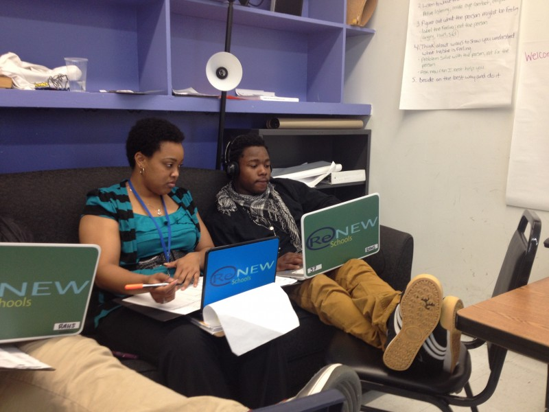 AmeriCorps member Arionne Hoskins works with student Michael Holmes, 19, on Spanish homework at ReNEW Accelerated High School.