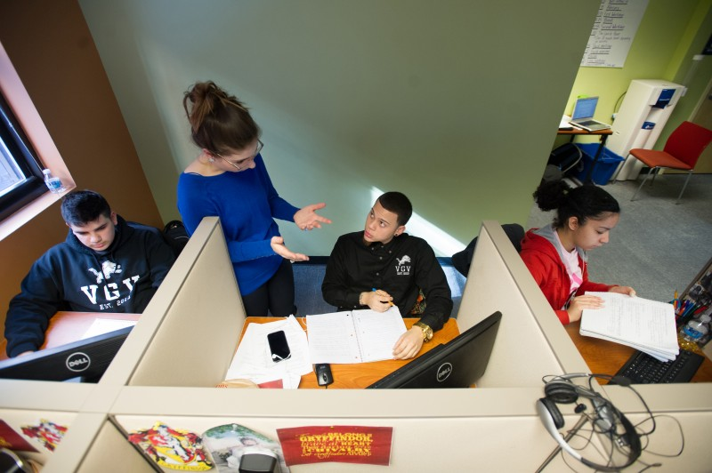 Village Green Virtual math teacher and learning center coordinator Bianca Toth talks with sophomore Hector Nieves, 16, of Lincoln. At left is sophomore Julio Sosa, 16, of Central Falls and at right is sophomore Francheska (cq) Rodriguez, 17, of Providence.