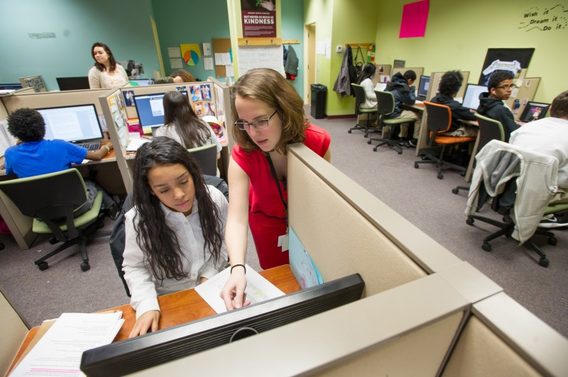 Village Green Virtual math teacher Maeve Murray helps sophomore Lisbel (cq) Gonzalez, 16, of Providence with an assignment inside the learning center. Students are expected to do inpendent work inside the learning center but teachers are available to give them one-on-one help.