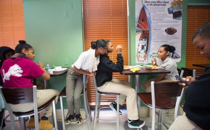 """Instead of a cafeteria, Village Green Virtual students eat in """"Hot City Cafe,"""" a corporate-style lunchroom."""