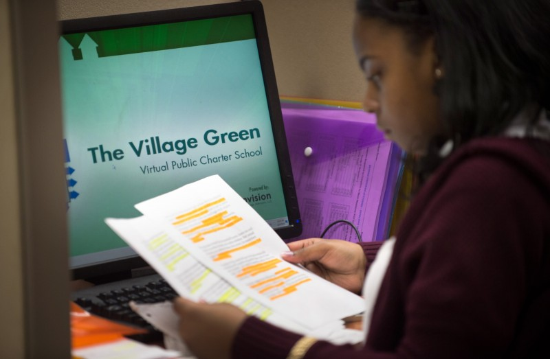 Village Green Virtual junior Destiny Taylor, 16, of Providence reviews papers at her work station in the learning center.