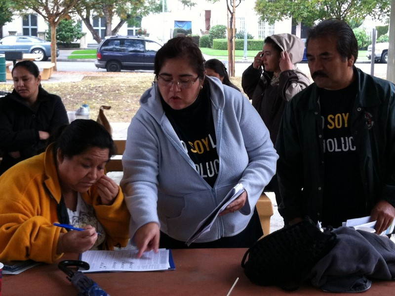 Parents from 24th Street Elementary in Los Angeles collect signatures for a parent-trigger petition campaign in January 2013. The campaign led to a compromise with the Los Angeles Unified School District that restructured the school into a hybrid charter school.