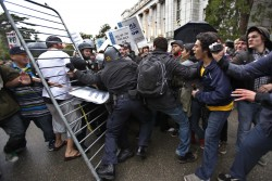 Demonstrators struggle with police with a barricade in front of a closed off building on the University of California, Berkeley on the Berkeley, Calif., campus, Friday,. Nov. 20, 2009, during a demonstration against university fee hikes and layoffs.