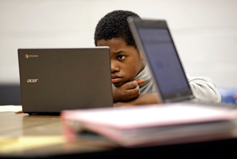 In this Feb. 12, 2015 photo, Marquez Allen, age 12, reads test questions on a laptop computer during in a trial run of a new state assessment test at Annapolis Middle School in Annapolis, Md. The new test, which is scheduled to go into use March 2, 2015, is linked to the Common Core standards, which Maryland adopted in 2010 under the federal No Child Left Behind law, and serves as criteria for students in math and reading.