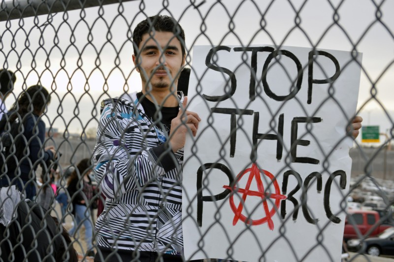 Muslim Alkurdi, 18, of Albuquerque High School, joins hundreds of classmates in Albuquerque, N.M, Monday, March 2, 2015, as students staged a walkout to protest a new standardized test they say isn't an accurate measurement of their education. Students frustrated over the new exam walked out of schools across the state Monday in protest as the new exam was being given. The backlash came as millions of U.S. students start taking more rigorous exams aligned with Common Core standards.