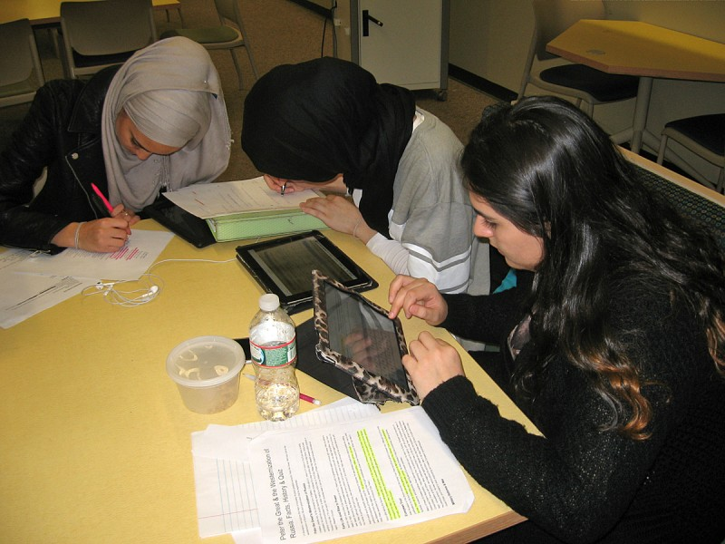 Revere High School juniors study together after learning they will be part of the inaugural group of students to take the PARCC exam. From left are Basma Mered, 17, Amina Mansouri, 16, and Raz Kamal, 17.