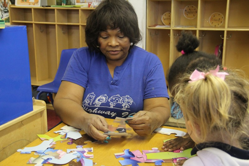Sherrie Jones plays with students at Highway 90 Daycare in Pascagoula, Miss. Jones said that private financial help was the only way she could fund improvements to her center.