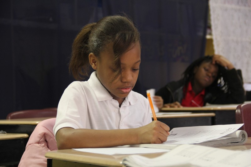 Fourth Grader Lakiya works on a writing assignment during social studies.