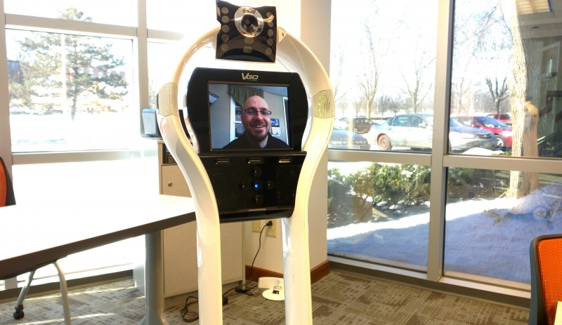 Teacher Thomas Fech, who teaches high school students remotely in a Columbus charter school, operates a telepresence robot.