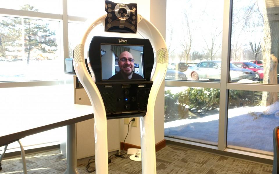 Teacher Thomas Fech, who teaches high school students remotely in a Columbus charter school, operates a telepresence robot.