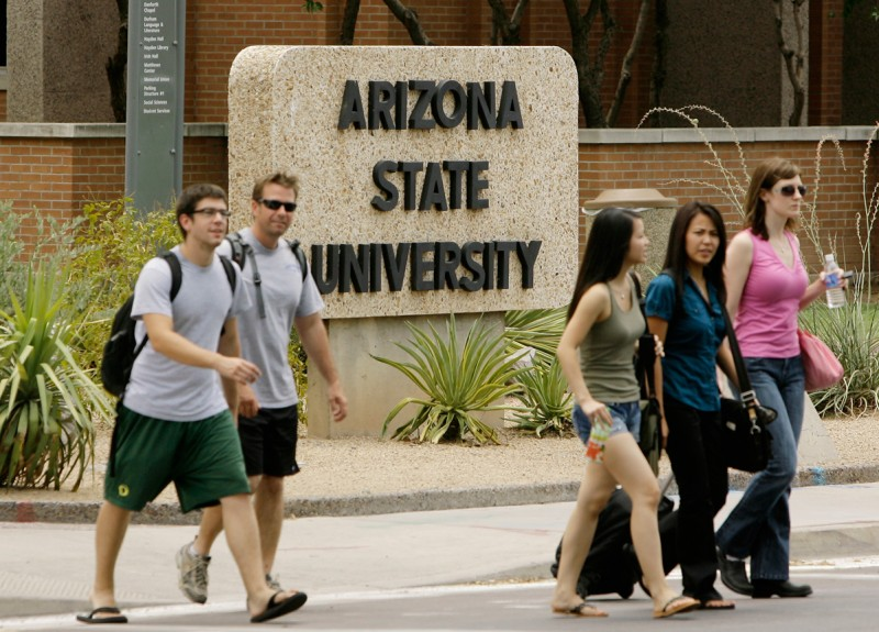 Students walk to and from classes on the campus of Arizona State University.