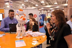 Lynne Kesselman, an Egg Harbor Township teacher, checks out a robot that can be used as a classroom teaching aid at the New Jersey Education Association convention at the Atlantic City Convention Center in Atlantic City, N.J., Thursday Nov. 7, 2013.