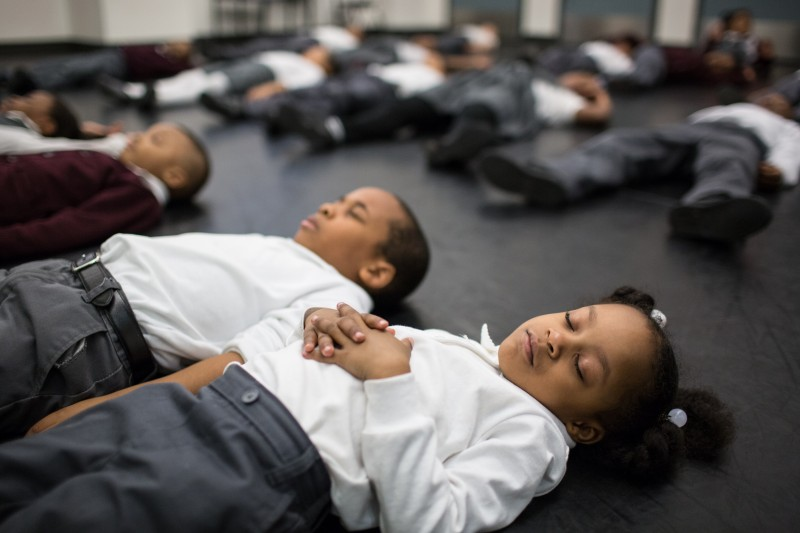 Kindergartners at Brownsville Ascend Lower School do a guided relaxation at the end of their dance class to help their focus when they return to academics.