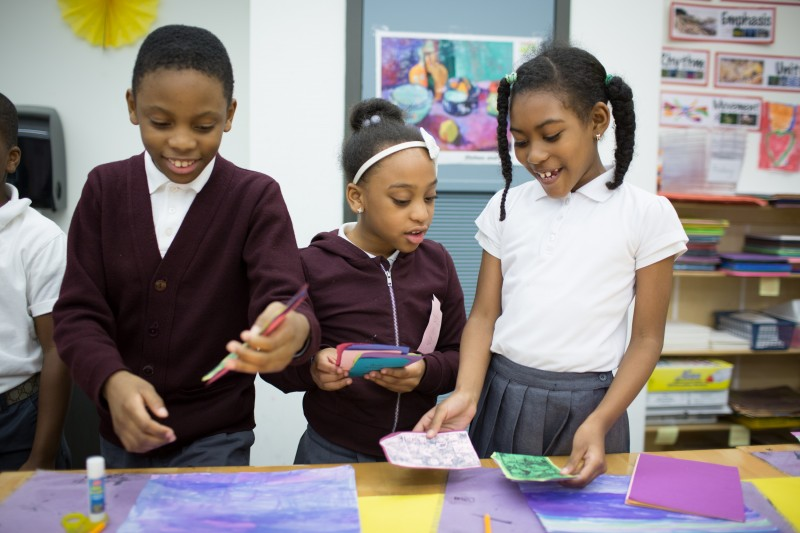 Third-grade students at Brownsville Ascend Lower School work on an art project about New York City architecture.