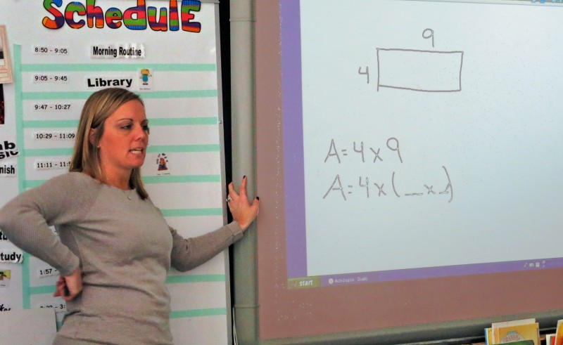 Third-grade teacher Morgan Mercaldi conducts one of several math classes she will sprinkle throughout the school day.