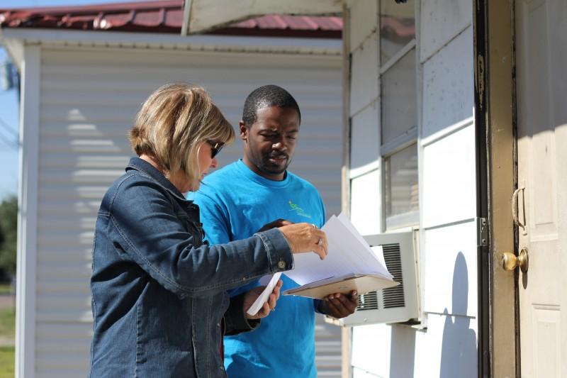 Workers from the Delta Health Alliance conduct door-to-door surveys in fall 2014.